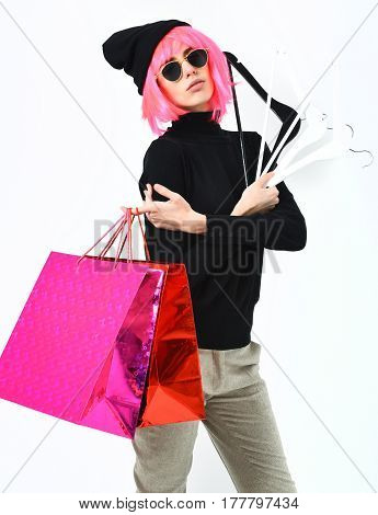 Fashionable Sexy Girl In Pink Wig Holding Package With Hangers