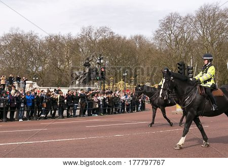LONDON - 17 March 2017 United Kingdom: Metro cop from horseback at Buckingham Palace in London. Police on horseback in the UK for the prevention of crime.