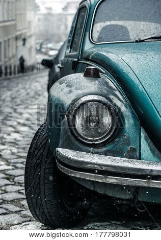 Poland, Warsaw: 03 December 2012. Old Old Blue Beetle Car Volkswagen Detail On The Street During Win