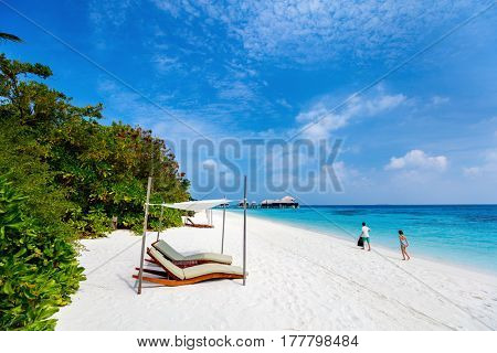 Little kids on a tropical beach during summer vacation
