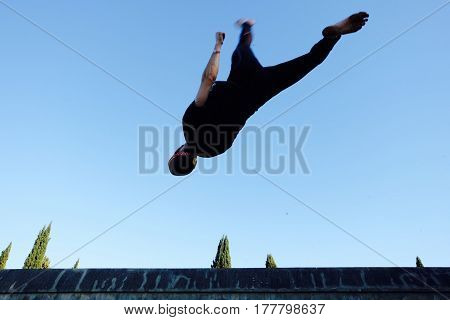 Man make backflip with clear sky as background