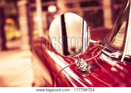 Red Retro Car On A Blurry Background. Detail: Rear View Mirror. Soft Focus