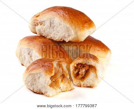 four homemade pies with cabbage isolated on white background.