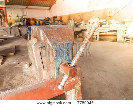 Old Bench Vise Hand Tool With Rust On Table