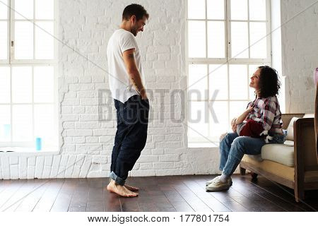 Young happy family relaxing at home on the floor