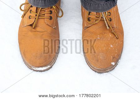 Brown shoes on snow top view very fancy fashion in winter