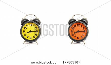 Closeup yellow alarm clock and orange alarm clock for decorate show a quarter past eight or 8:15 a.m. isolated on white background
