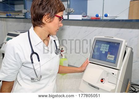 Doctor use equipment for blood gases analysis at laboratory