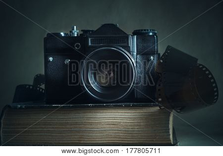 Old analog camera on the old book
