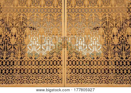 Beautiful golden Forged gates design thai temple. Thailand decor