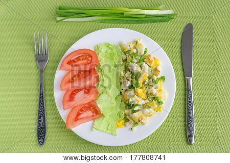 scrambled eggs, pita bread, tomatoes and onions for breakfast