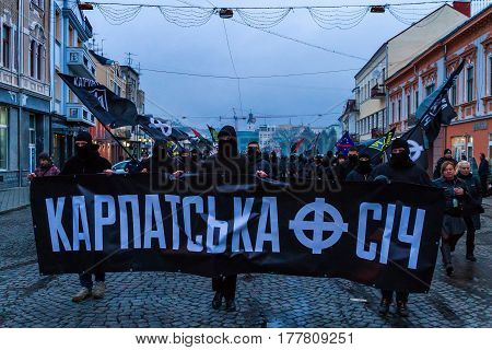 Uzhhorod western Ukraine - March 18 2017: Activists of the Black March of the Glory of the Heroes of Carpathian Ukraine walk through the streets of Uzhhorod.