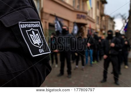 Uzhgorod west of Ukraine - March 18 2017: Chevron on the sleeve of the uniform of the activist during the Black March of Heroes of the Carpathian Ukraine in Uzhgorod.