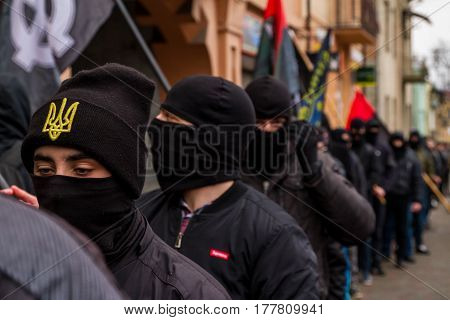 Uzhhorod western Ukraine - March 18 2017: Masked activists partake in the Black March of the Glory of the Heroes of Carpathian Ukraine in Uzhhorod.