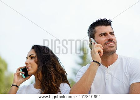Man And Woman On Talking On Cellphones