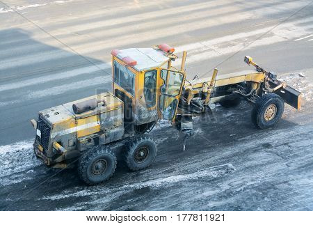 Road construction equipment. Yellow grader. Top view