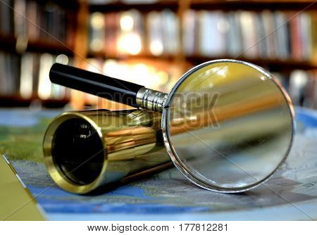 close up geographic map telescope magnifying glass to study and travel
