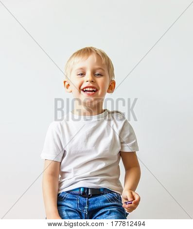 Happy Cheerful Little Boy, Playing Laughing Making A Face