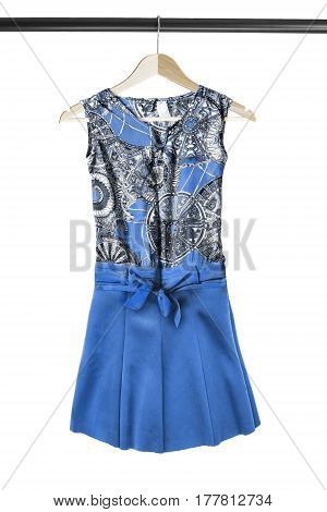Elegant silk blue sundress on wooden clothes rack isolated over white