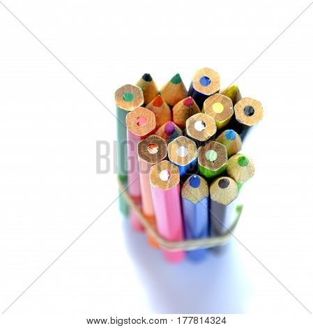 group of colored pencils in a pile in the macro