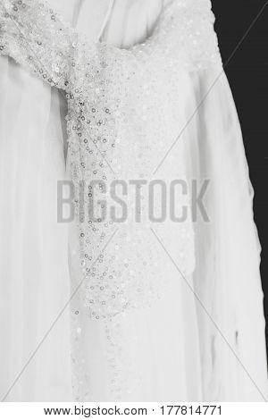 A Veil Belt With Crystals Hangs On A White Dress