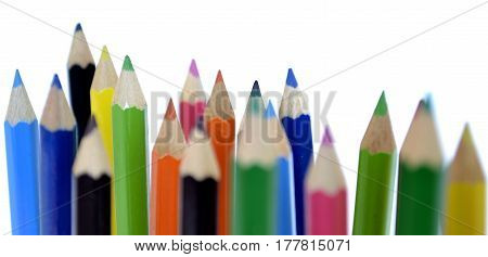 Group of different colored pencils on white background