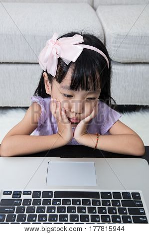 Fatigued Asian Chinese Little Girl Looking At Computer Screen