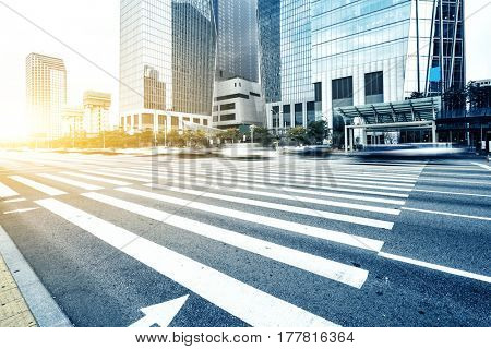 modern office buildings in seoul with sunbeam from empty road