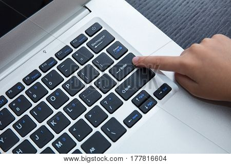 Close Up Aerial View Of Children Hands Pressing Enter Button