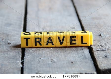 Travel concept. Word on a wooden old table