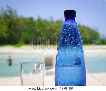 Plastic Bottle Of Water On The Beach