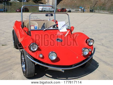 Mele Italy - 15 August 2015 - Summer Gathering: A Red Dune Buggy during a gathering of vintage cars.