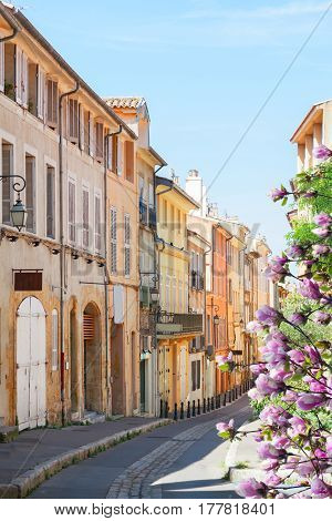 old town street of Aix en Provence at spring day, France