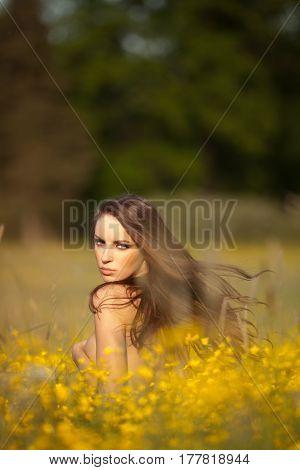 Sensual handbra woman on bright summer field