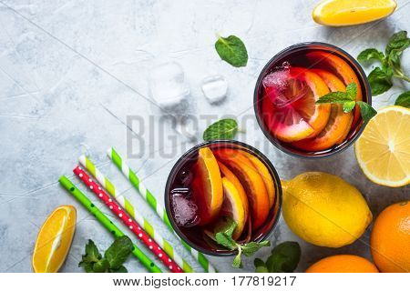 Sangria with fruit mint and ice. Traditional alcoholic cocktail. Summer drink. Red wine.