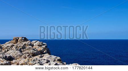 Historical Artillery Facilities near Punta Nati against Blue Sky Outdoors. North West of Menorca Balearic Islands
