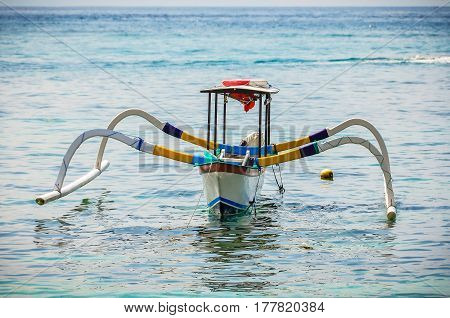 PADANGBAI, INDONESIA - SEPTEMBER 30, 2017: Typical Balinese boat used by local fishermen on Bali Island Indonesia