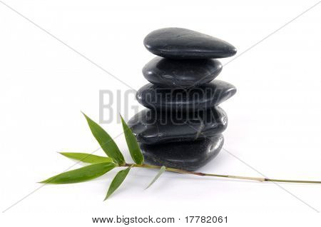 Black zen stones with bamboo leaf