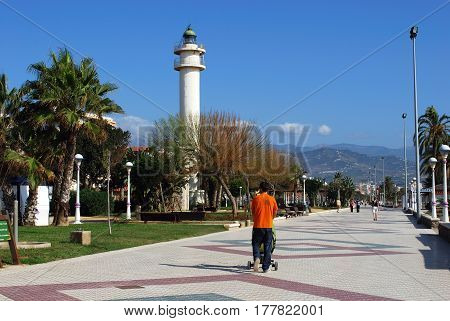 TORRE DEL MAR, SPAIN - OCTOBER 27, 2008 - View along the promenade with the lighthouse to the left hand side Torre del Mar Malaga Province Andalusia Spain Western Europe, October 27, 2008.