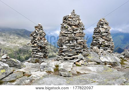 Big stones cairns near mountain top Medelzkogel in National park Hohe Tauern, Austria. poster