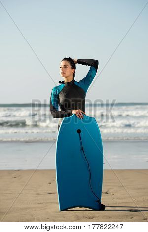Portrait Of Surfer Woman With Bodyboard Against The Sea