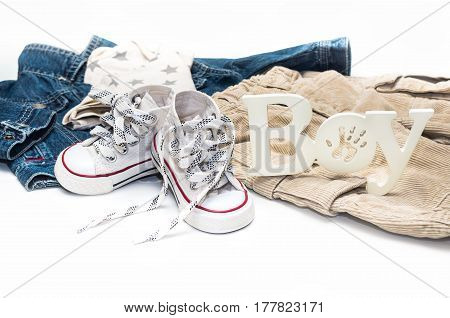 Set Of Baby Clothes For A Little Boy On A White Background.