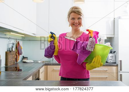 Woman getting ready for spring cleaning with cleaning basket