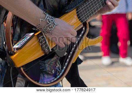 Hands of a guitar player playing electric guitar. Live sound