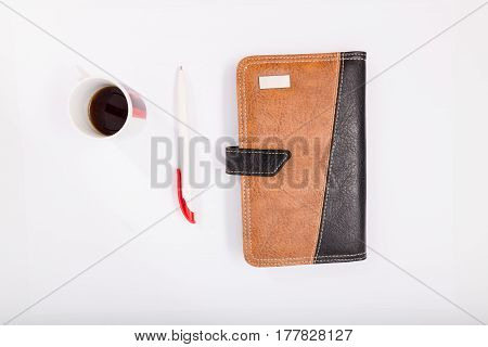 Notebook With Pen On White Background. Isolate