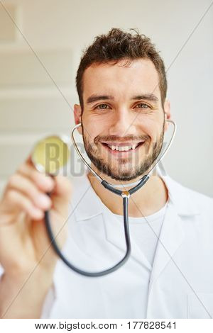 Physician with stethoscope smiling friendly