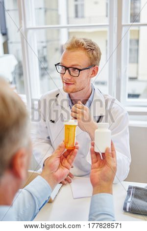 Doctor prescribes medicament with tablets to patient in consultation