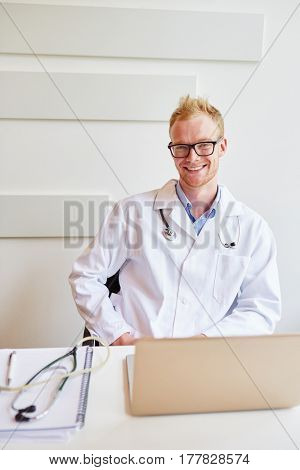 Man as physician at his office smiling