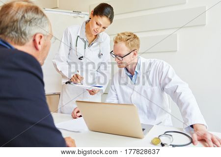 Doctors giving advice to patient about diagnose and treatment