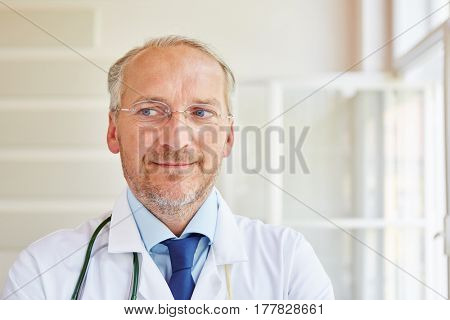 Senior as competent doctor and chief physician at hospital